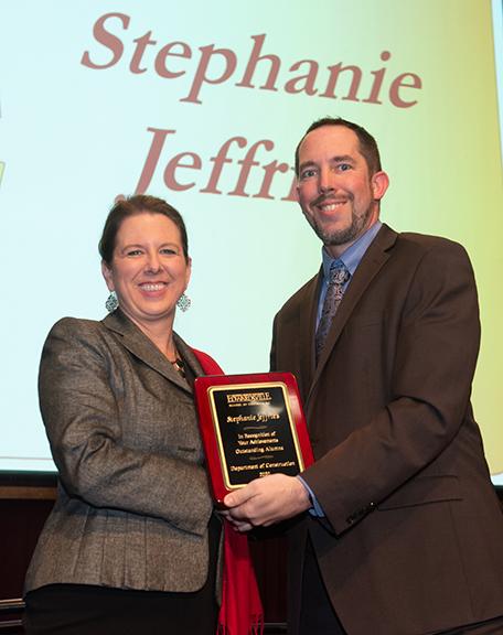 Stephanie Jeffries on stage with her award